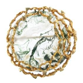 A 9ct gold moss agate brooch. Of openwork, the circular