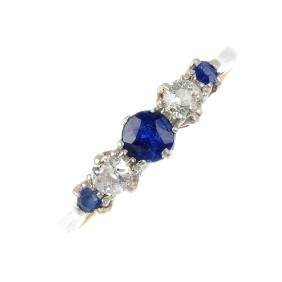 A sapphire and diamond five-stone ring. The
