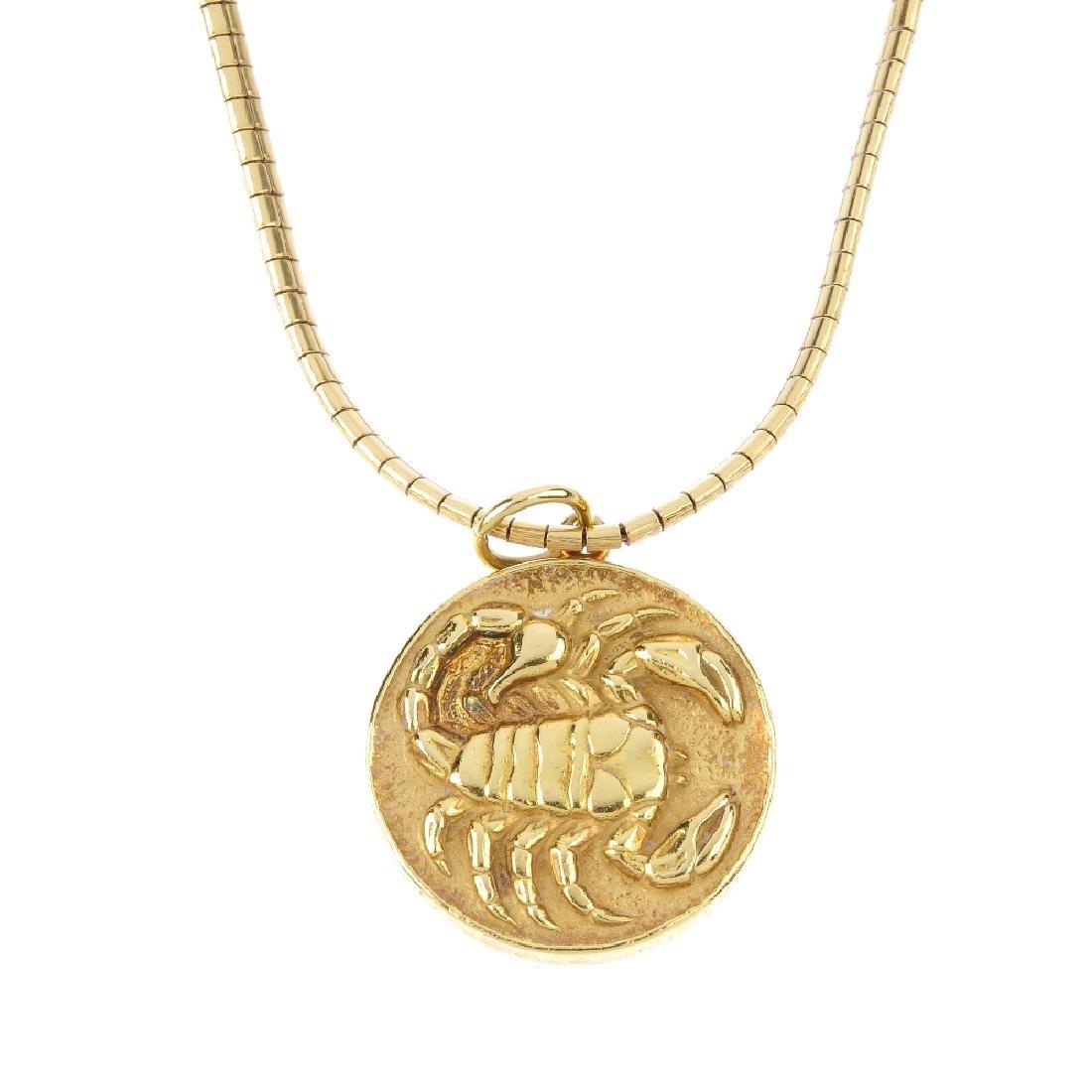 A 1970s 18ct gold 'Scorpio' zodiac pendant. The