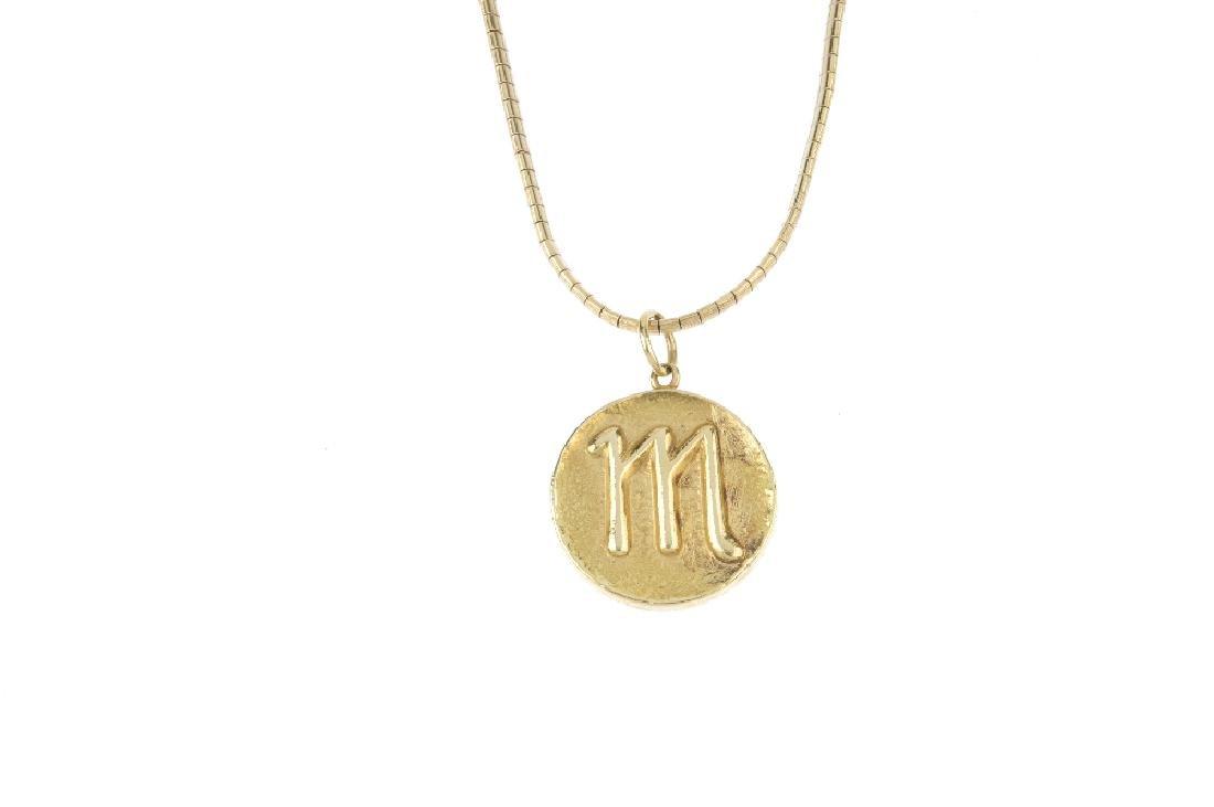 A 1970s 18ct gold 'Scorpio' zodiac pendant. The - 2