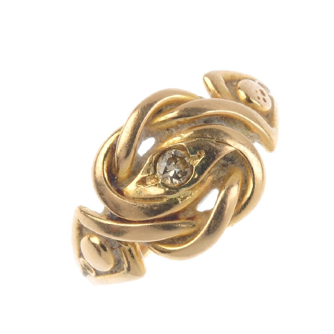 An early 20th century gold diamond dress ring. The