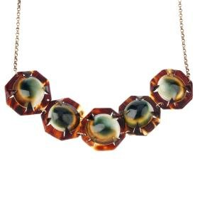 An operculum and tortoiseshell necklace. Comprising