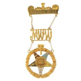 A 9ct gold and enamel Masonic brooch. Designed as a