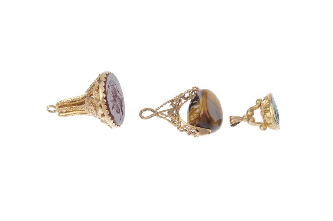 Three 9ct gold hardstone fobs. To include a carved - 2