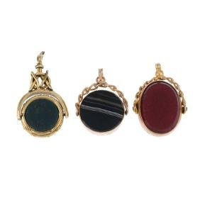 Three hardstone fobs and a two similarly-set watch