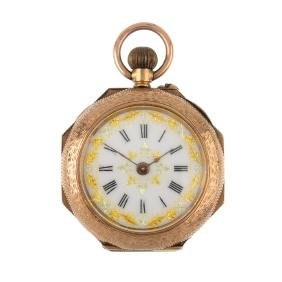 A 9ct gold enamel fob watch. The white enamel dial with