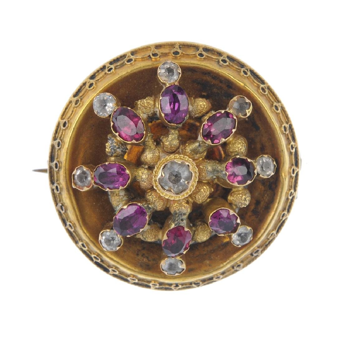 A late Victorian gold gem-set brooch. The