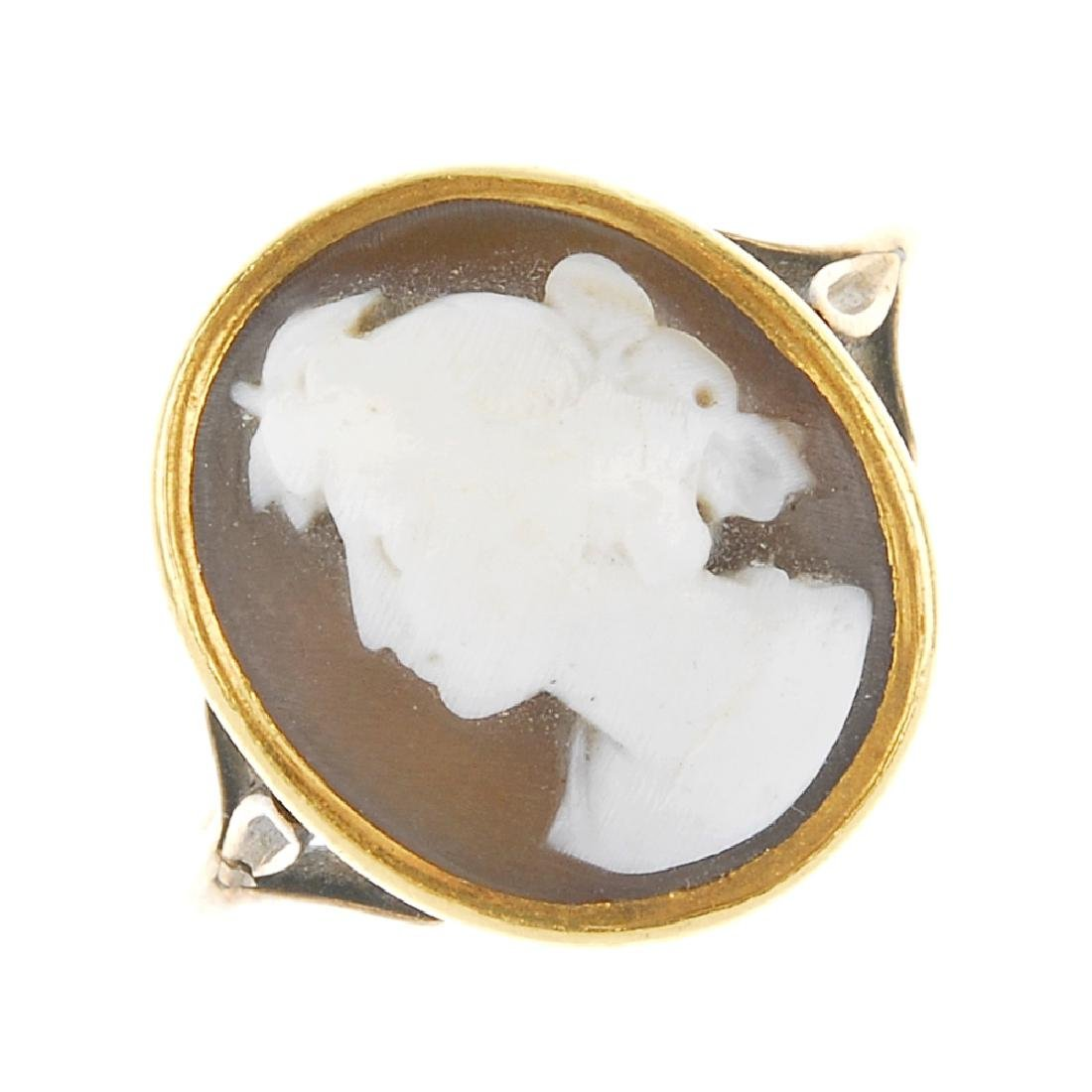 Four cameo rings. Each designed with oval cameo panels