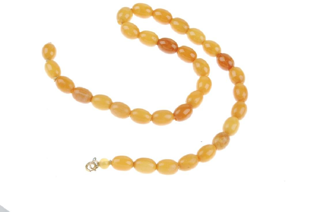 A natural amber bead necklace. The single row of - 2
