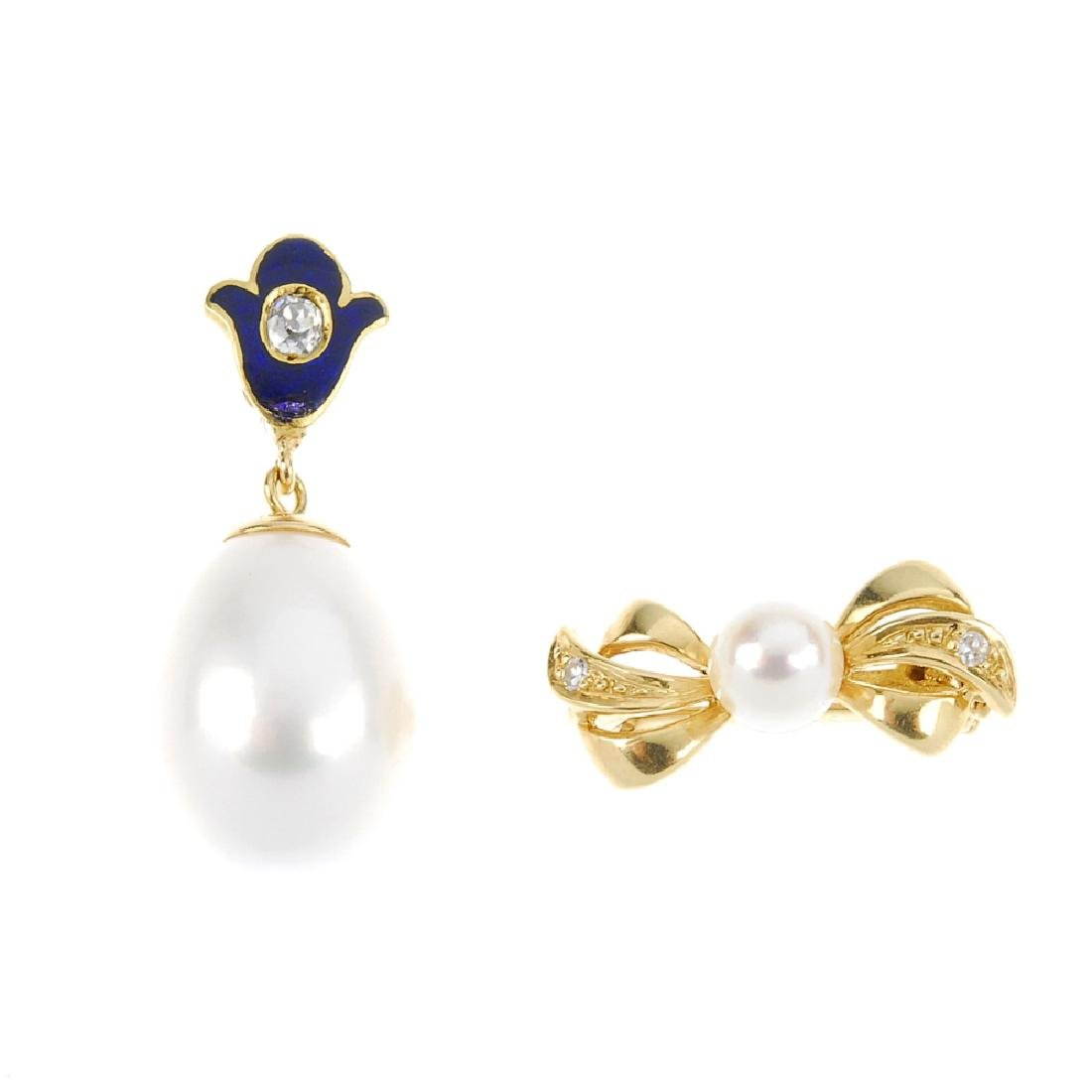 A cultured pearl and diamond spacer and pendant. The