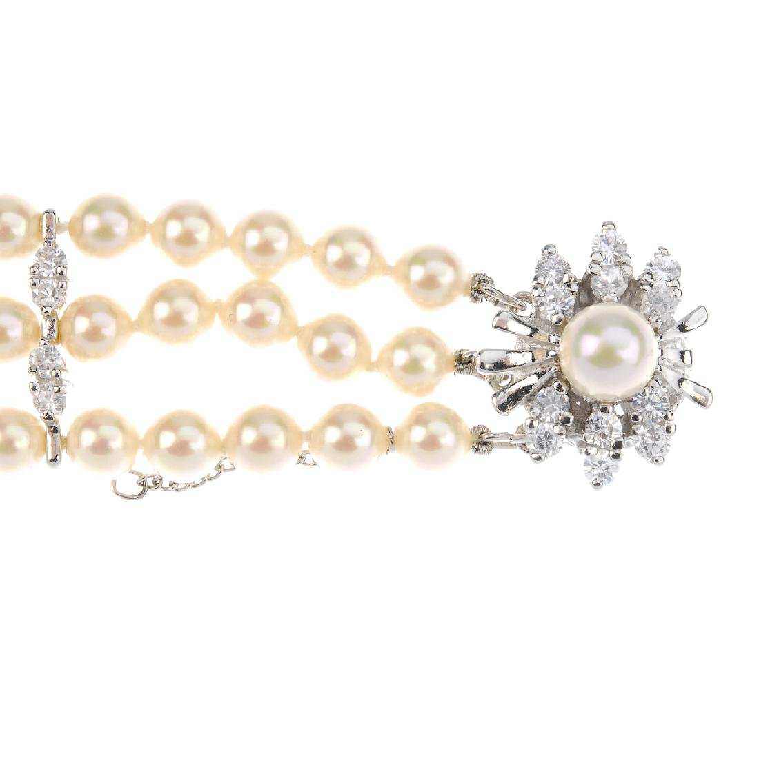 A paste and imitation pearl bracelet. The three rows of