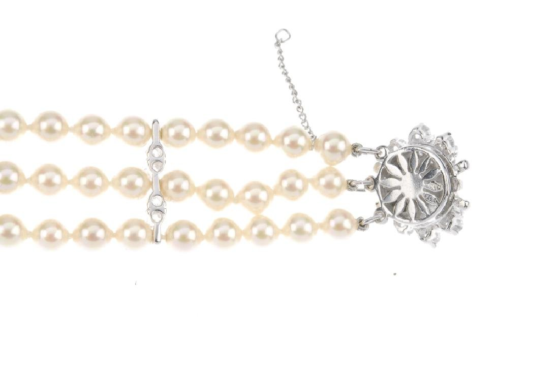A paste and imitation pearl bracelet. The three rows of - 2
