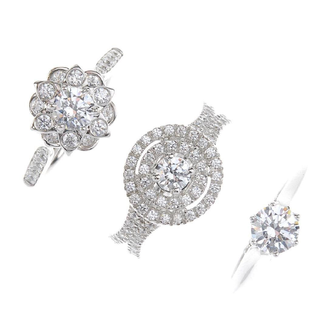 Three cases of cubic zirconia set sample rings. Stored