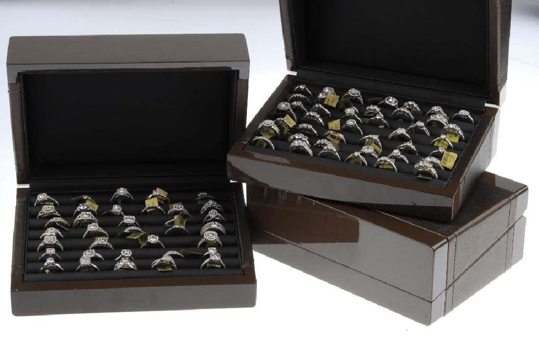Three cases of cubic zirconia set sample rings. Stored - 2
