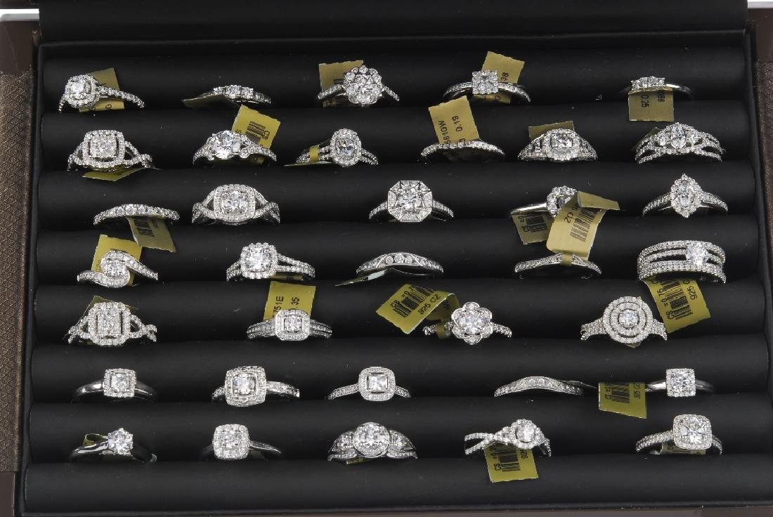 Three cases of cubic zirconia set sample rings. Stored - 3