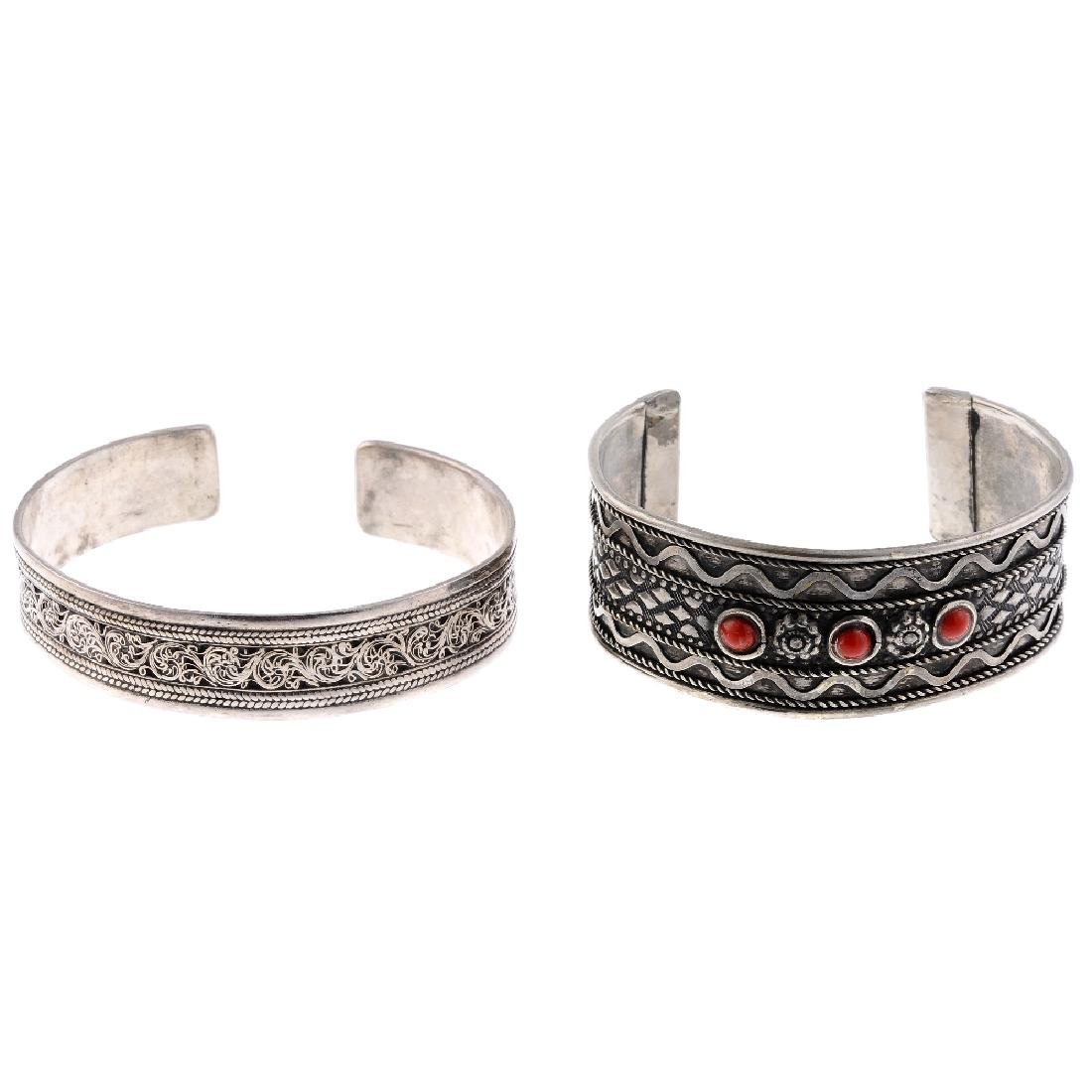 A selection of silver and white metal bangles. The