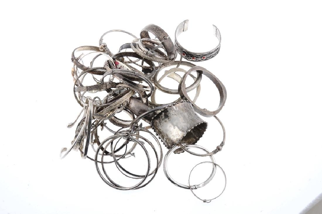A selection of silver and white metal bangles. The - 2