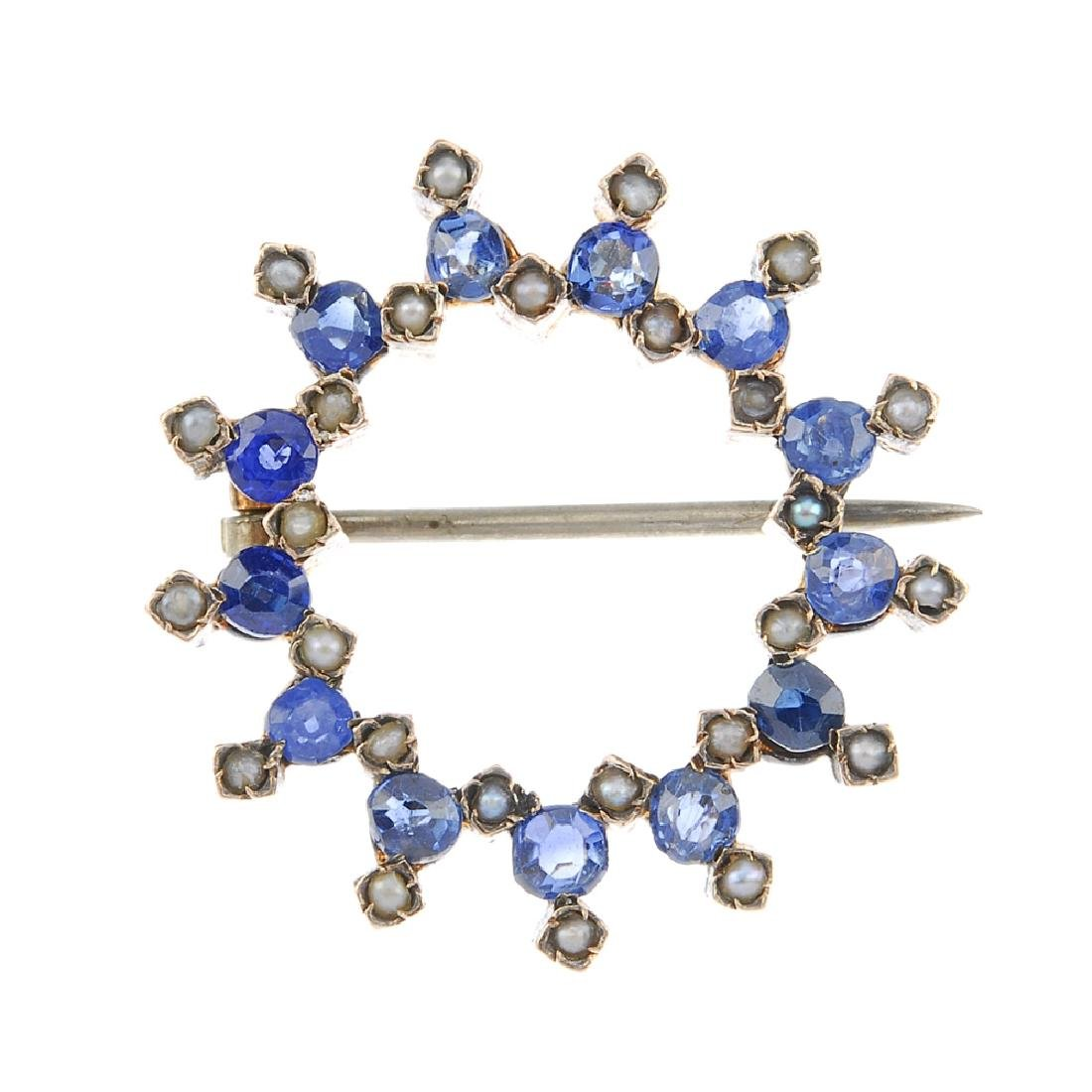 A sapphire and split pearl wreath brooch. Designed as a