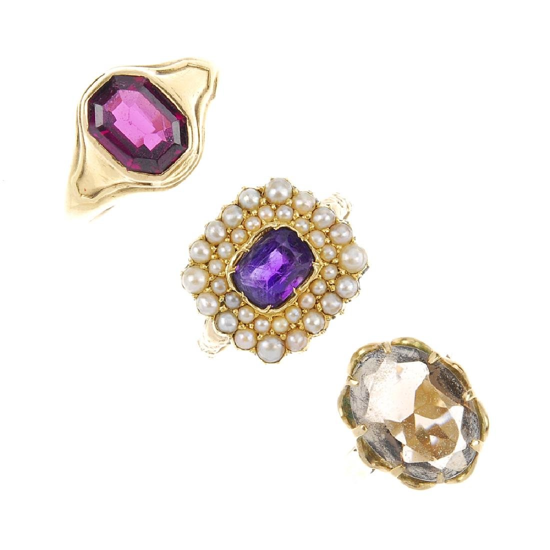 Three rings. The first a rectangular amethyst claw-set