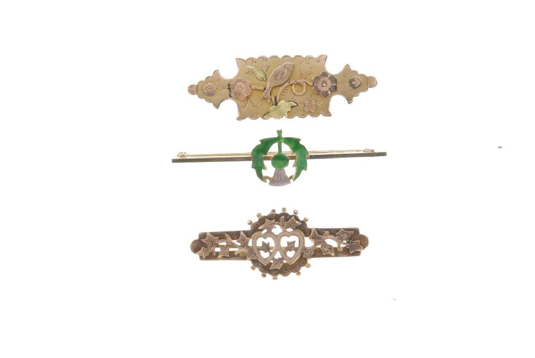 Three 9ct gold brooches. The first a bar brooch with