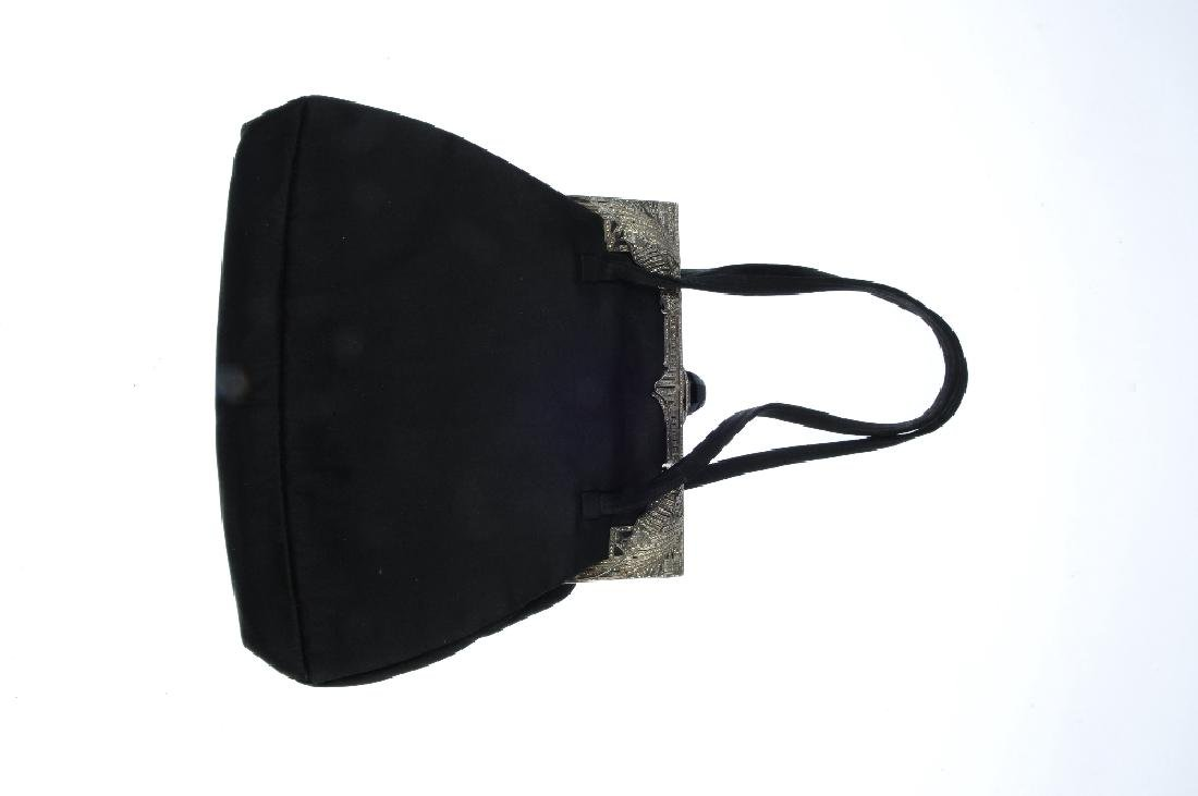To include a black evening bag with a silver and - 3