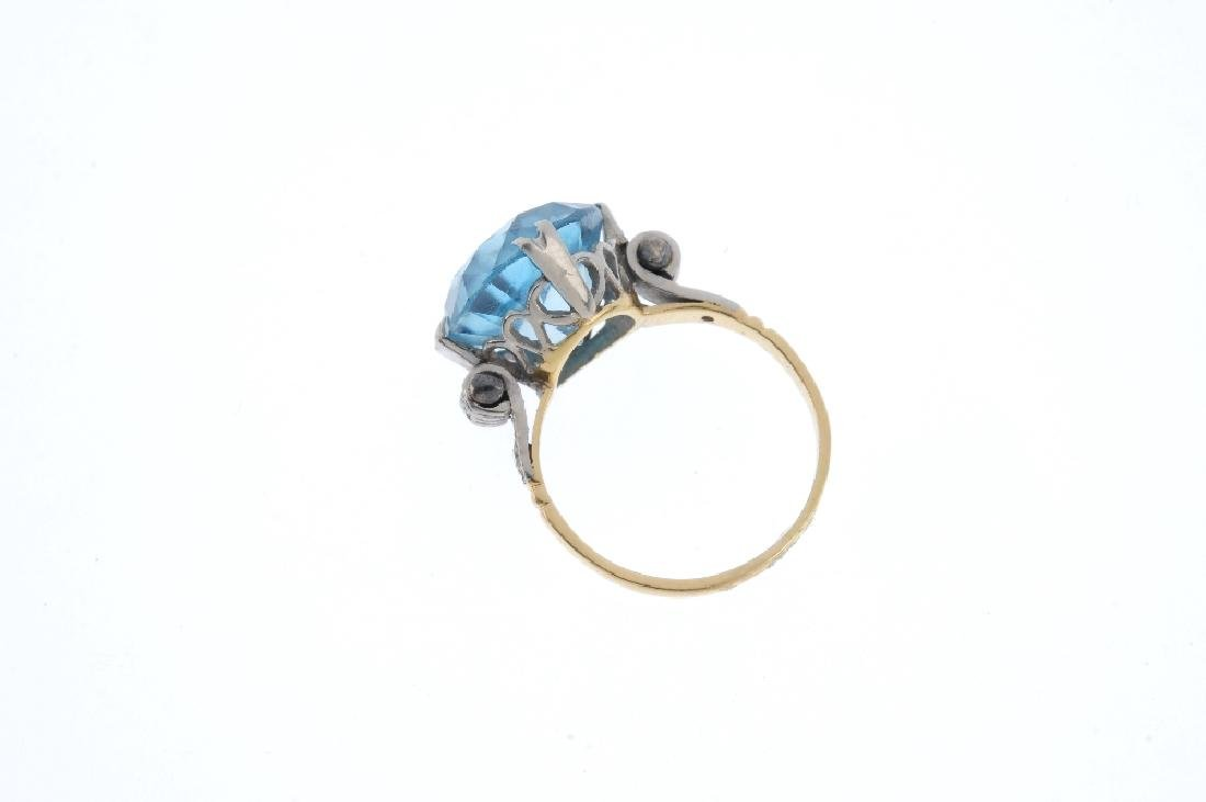 A zircon single-stone ring. The circular-shape blue - 2