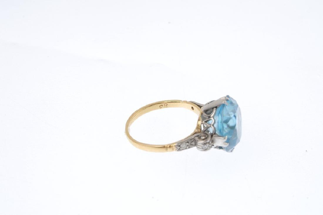 A zircon single-stone ring. The circular-shape blue - 3