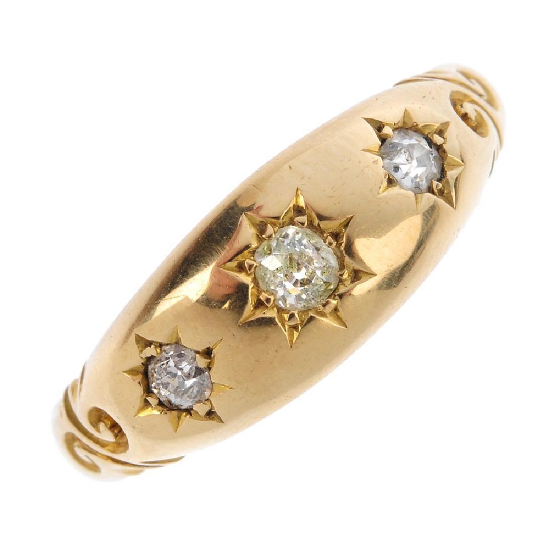 An early 20th century 18ct gold diamond three-stone