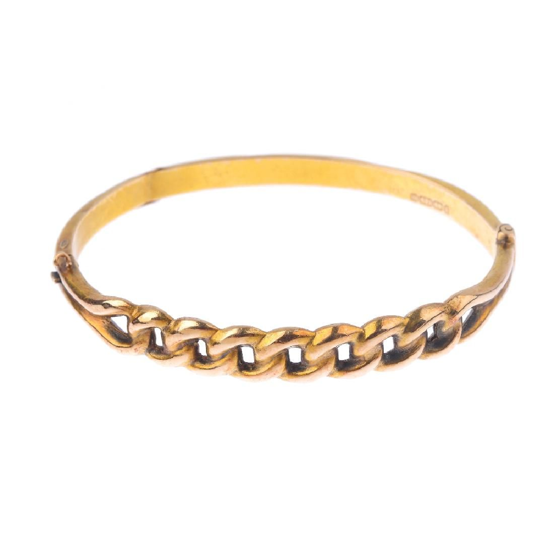 A late Victorian 15ct gold hinged bangle. Designed as a