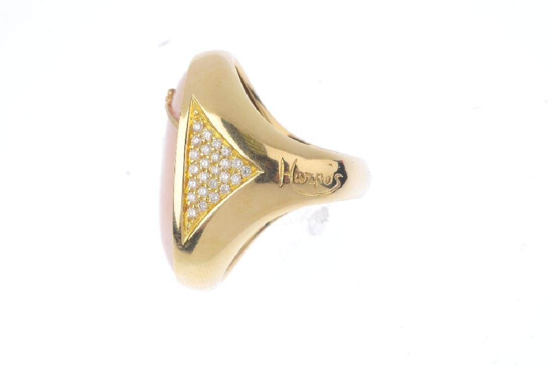 An 18ct gold dress ring. Designed as an oval onyx and - 2
