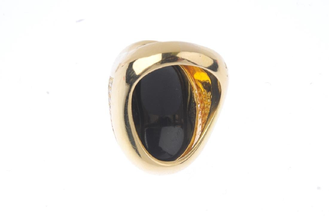 An 18ct gold dress ring. Designed as an oval onyx and - 3