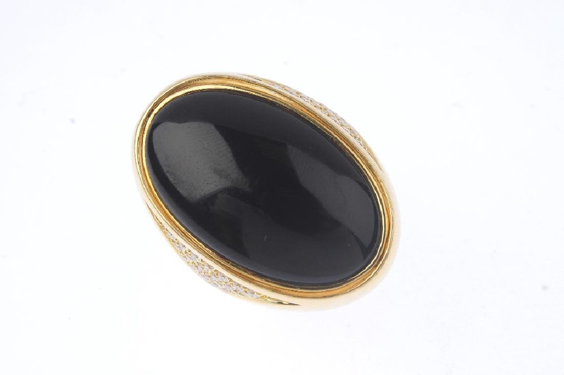 An 18ct gold dress ring. Designed as an oval onyx and - 4