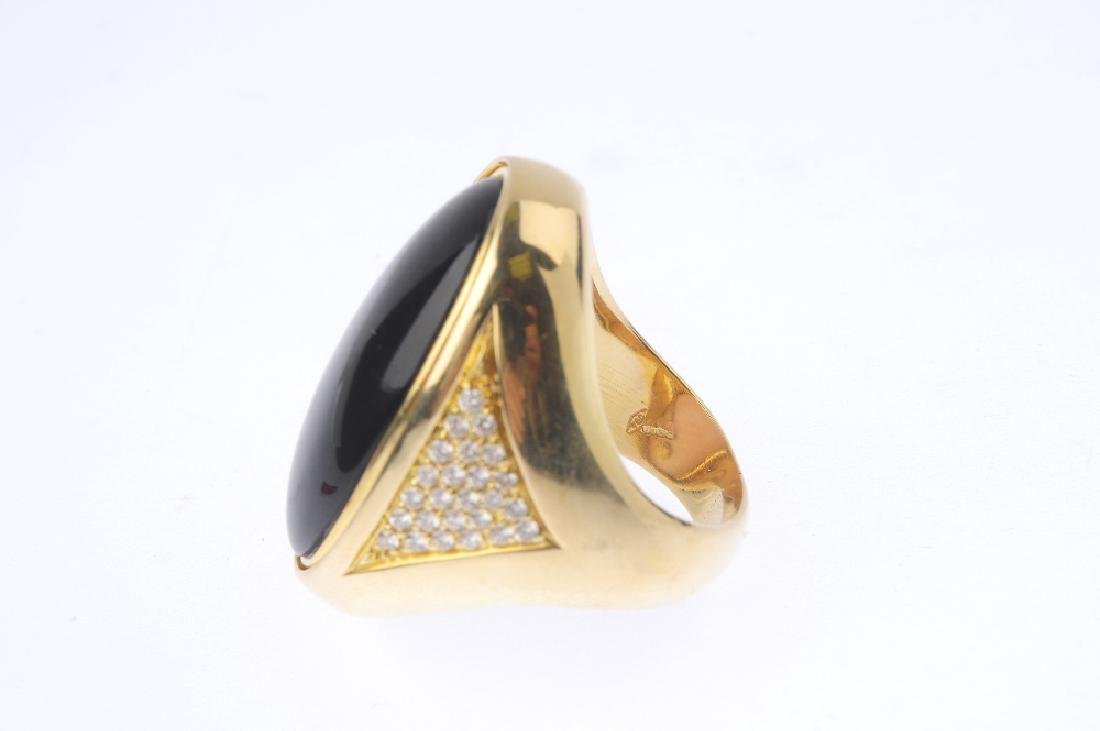 An 18ct gold dress ring. Designed as an oval onyx and - 5