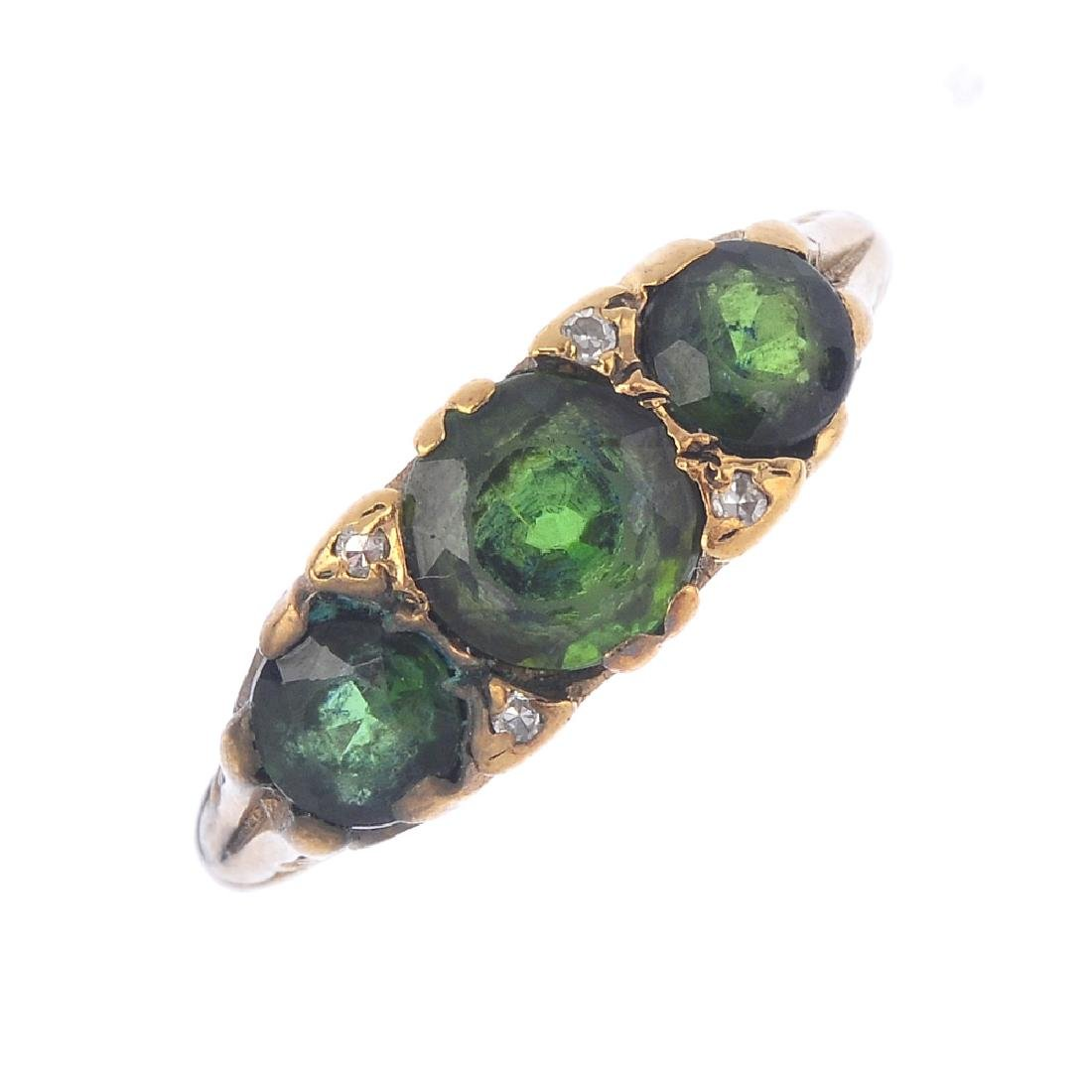 A tourmaline and diamond three-stone ring. The