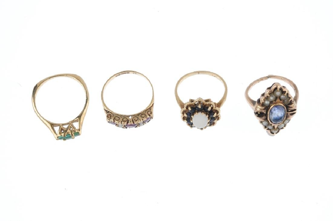 Four gem-set rings. To include a 9ct gold garnet - 2