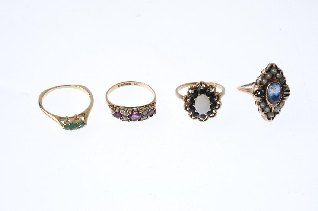 Four gem-set rings. To include a 9ct gold garnet - 3