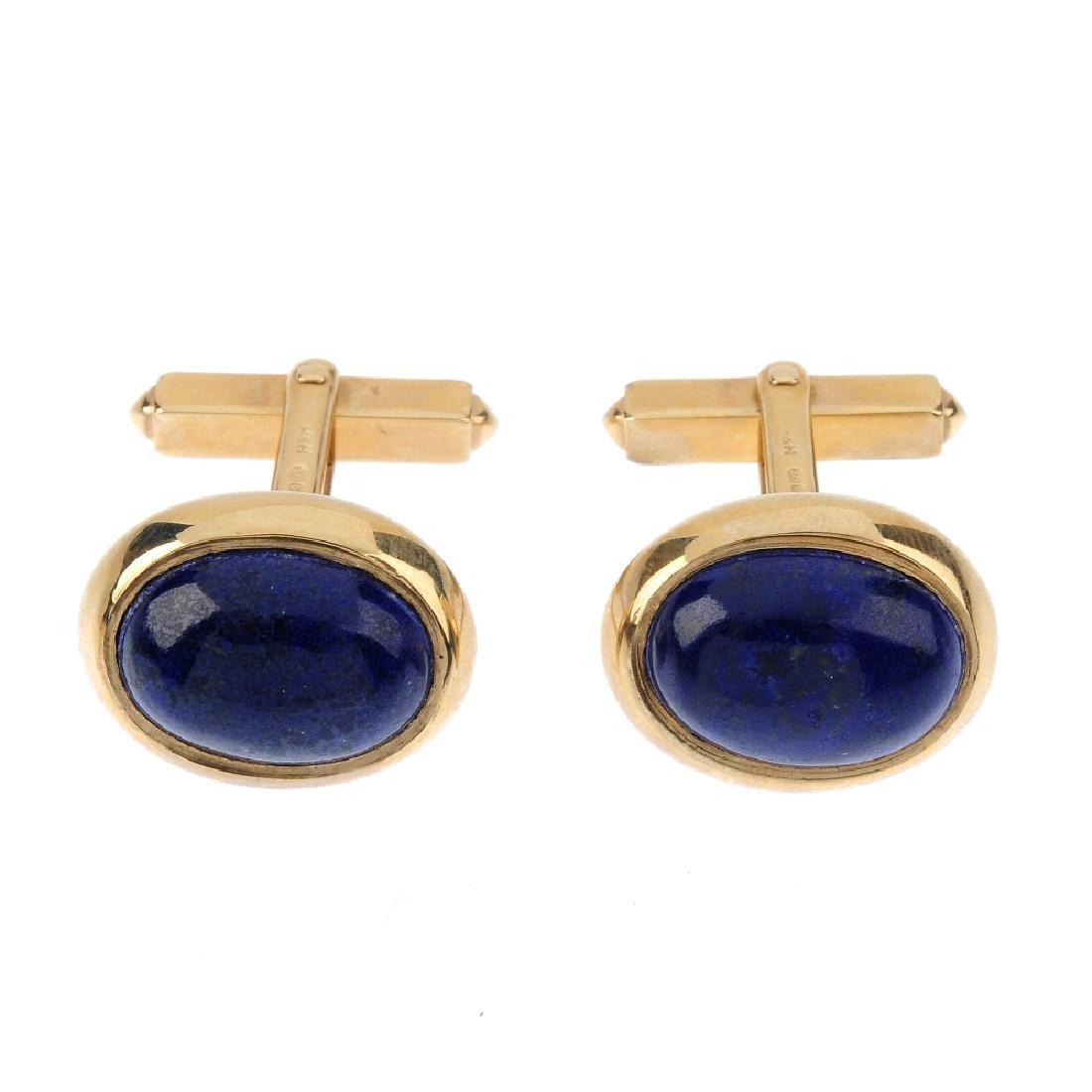 A pair of 9ct gold lapis lazuli cufflinks. Each