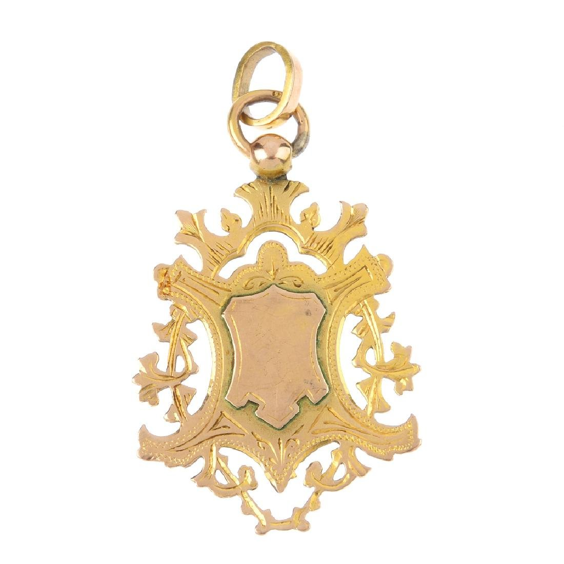 A late Victorian 9ct gold medallion. The vacant