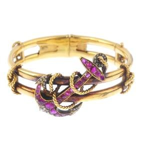 A mid Victorian 18ct gold, ruby and diamond bangle,