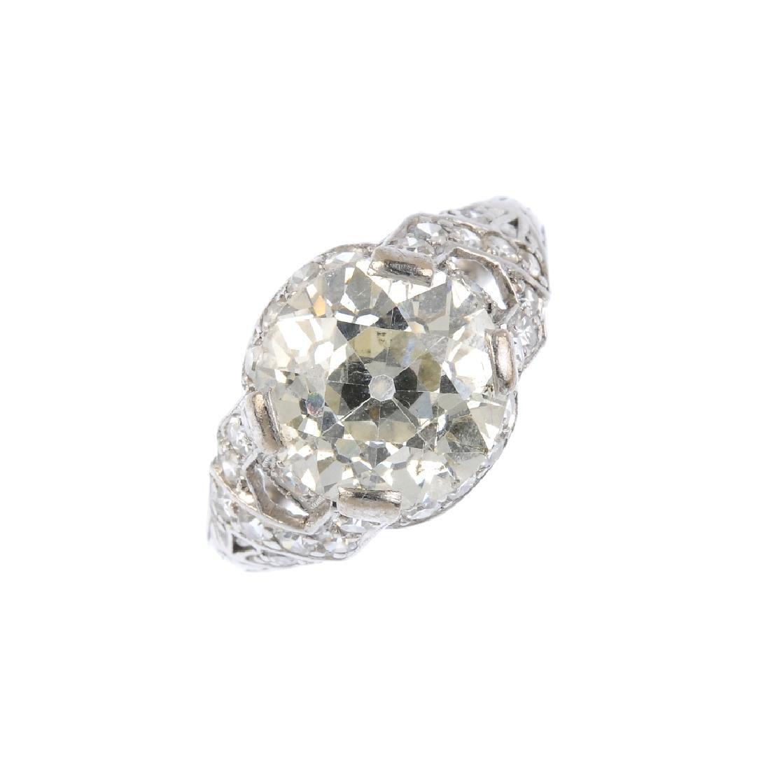 An Art Deco platinum diamond single-stone ring. The