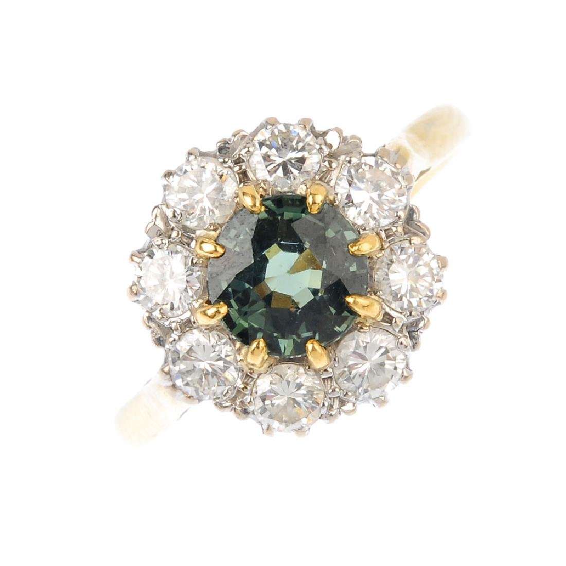 A sapphire and diamond cluster ring. The circular-shape