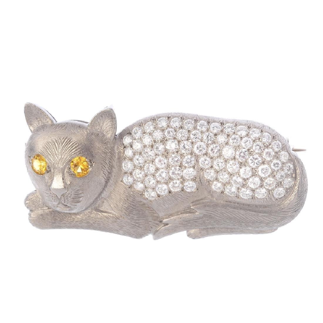 A sapphire and diamond novelty brooch. Designed as a