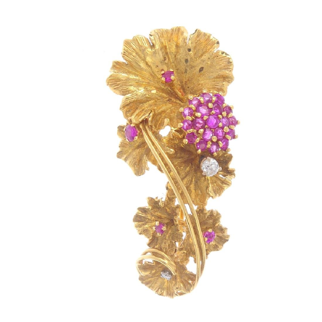 A 1960s 18ct gold diamond and ruby brooch. The