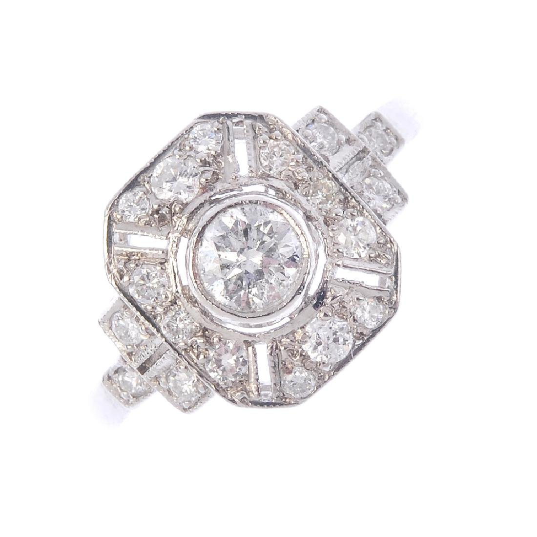 A diamond cluster ring. Of geometric design, the