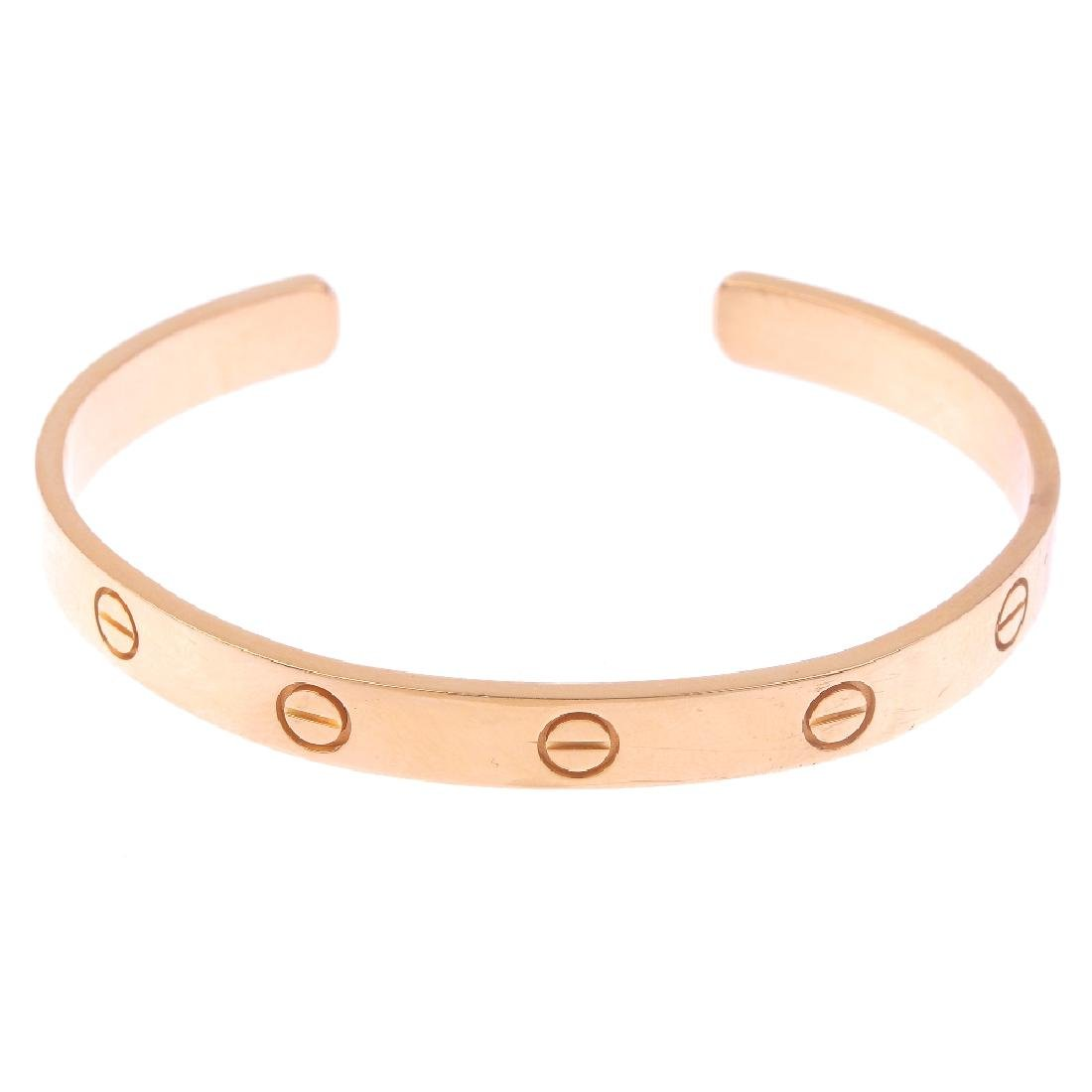 CARTIER - an 18ct gold 'Love' bangle. The open bangle,