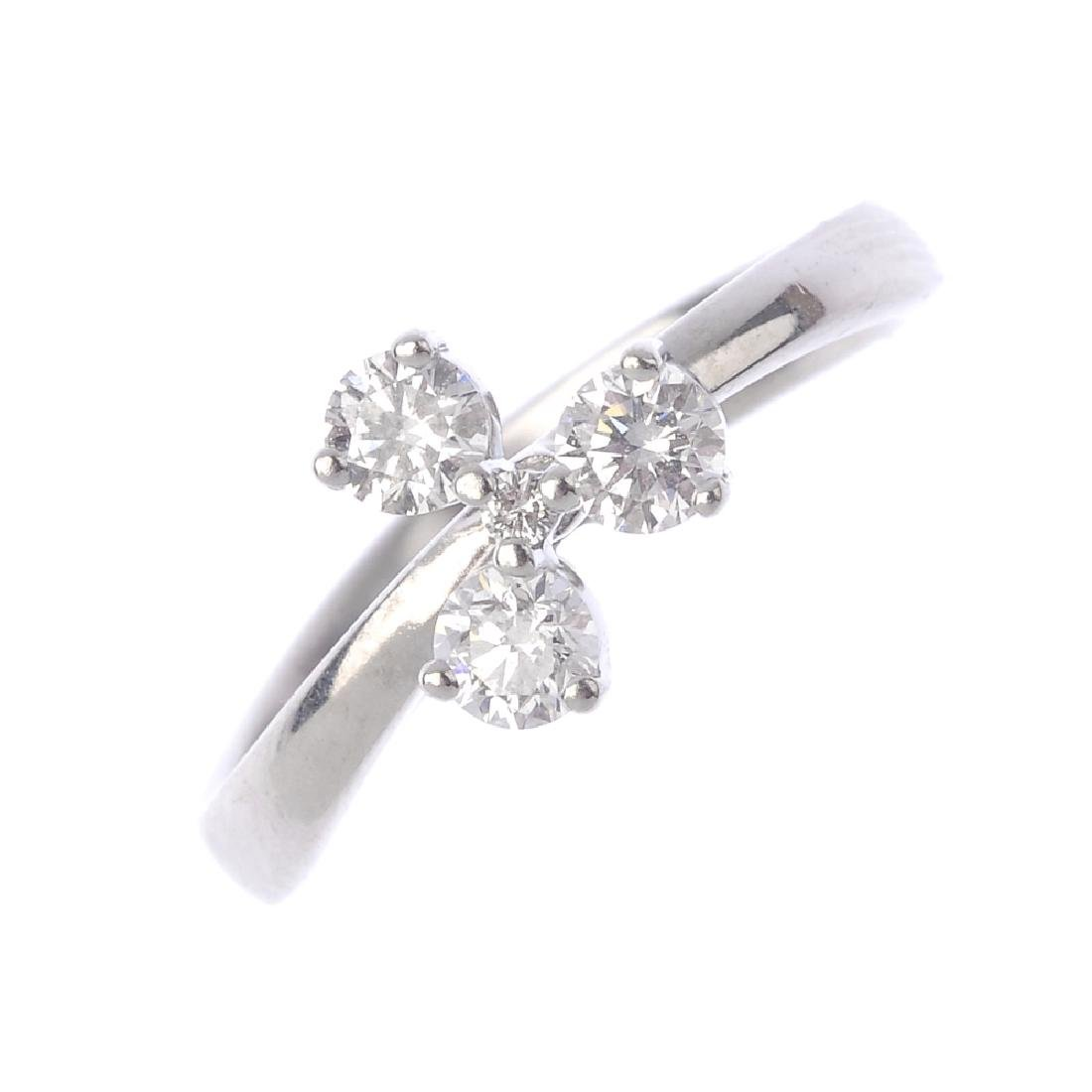 DE BEERS -  an 18ct gold diamond floral dress ring. The