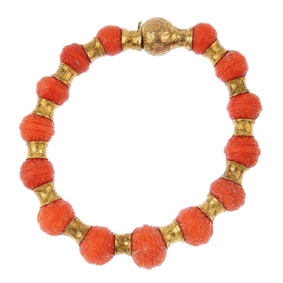 A coral bracelet. Designed as a series of floral