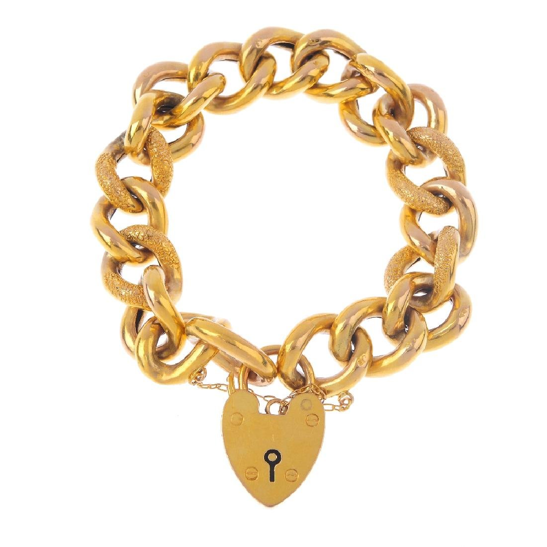 An early 20th century 9ct gold bracelet. The curb-link