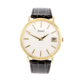 PIAGET - a gentleman's wrist watch. Yellow metal case
