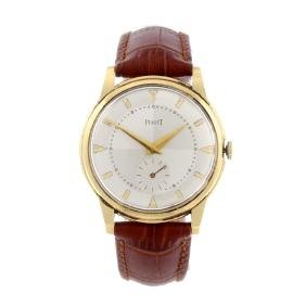 PIAGET - a gentleman's wrist watch. 18ct yellow gold